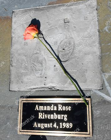 View of rememberance stone in memory of Amanda Rose Rivenburg, at the Reflections Memorial unveiling ceremony, on the one year anniversary of the Schoharie limousine crash that killed 20 people next to the Apple Barrel Restaurant, in Schoharie, N.Y