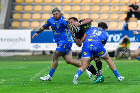 Michelangelo Biondelli of Zebre is tackled by Richard Hibbard and Tyler Morgan of Dragons