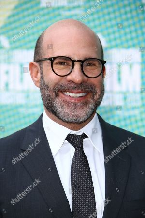 Scott Z. Burns poses for photographers upon arrival at the premiere of the film 'The Report' which is screened as part of the London Film Festival, in central London