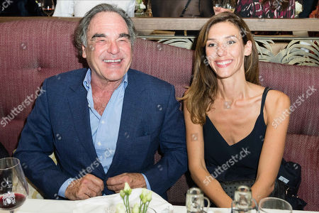 Oliver Stone and Doria Tillier