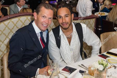 Daniel Grieder and Lewis Hamilton