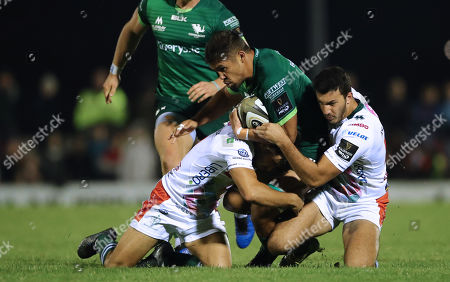 Connacht vs Benetton Rugby. Benetton's Luca Petrozzi and Leonardo Sarto tackle Jarrad Butler of Connacht