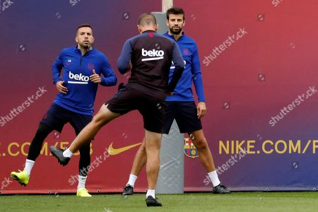 Stock Picture of FC Barcelona's Jordi Alba (L) and Gerard Pique (R) attend a training session at the Joan Gamper sports facilities in Barcelona, Spain, 05 October 2019. FC Barcelona will face Sevilla FC on 06 October on a Spanish LaLiga soccer match.
