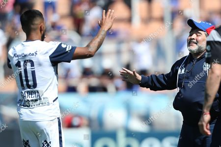 Stock Picture of Gimnasia's head coach Diego Maradona (R) celebrates a goal of Marias Garcia (L) during a game of the Argentine Superliga between Godoy Cruz of Mendoza and Gimasia of La Plata, at the Malvinas Argentinas Stadium of Mendoza, Argentina, 05 October 2019.