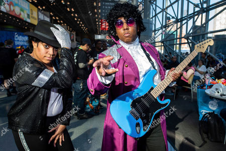 Attendees dressed as Michael Jackson and Prince pose during New York Comic Con at the Jacob K. Javits Convention Center, in New York
