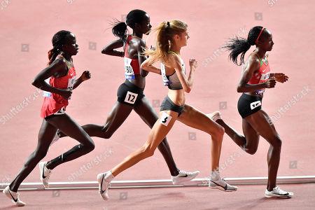 Hellen Obiri, of Kenya, Konstanze Klosterhalfen, of Germany, Margaret Chelimo Kipkemboi, of Kenya, and Lilian Kasait Rengeruk, of Kenya, from the right, compete in the women's 5000 meter final during the World Athletics Championships in Doha, Qatar