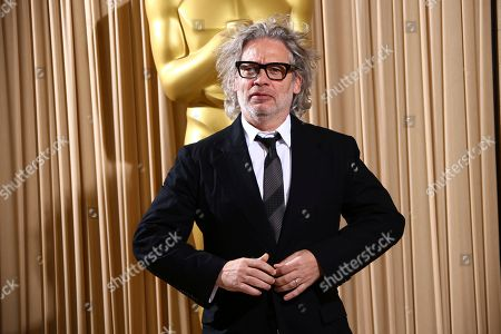 Dexter Fletcher poses for photographers upon arrival at the The Academy of Motion Pictures and Sciences new members reception in central London