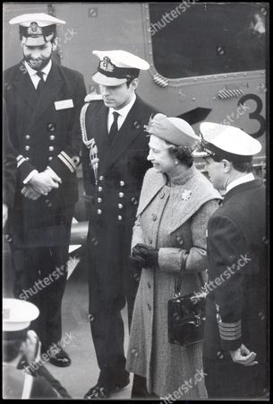 Stock Image of The Queen Visits Prince Andrew Onboard The Hms Brazen In The Pool Of London. It Isn't Every Day That The Travelling Public Catch Sight Of The Queen's Breakfast. But It Happened Yesterday On A Rail Trip The Queen Will Want To Forget. The Train Taking Her To See Her Sailor Son Prince Andrew In London Broke Down Eight Times A Substitute Locomotive Was Brought In And She Got To Town 43 Minutes Late. But First She Had An Hour's Wait For Breakfast. The Door Between The Royal Party's Coach And The Breakfast Car Was Locked For Security Reasons... And No-one Could Find The Key. As Stewards Struggled To Open The Door The Queen Travelling In A Reserved Coach On The 7.50am From King's Lynn Waited Patiently. Fortunately The Chief Steward Used His Loaf And Took Advantage Of The Train Stopping At Ely ' Said A Br Spokesman. Silver Platters Of Kipper Bacon Eggs Toast And Coffee Were Carried Out Of The Breakfast Car. Minutes After The Unexpected Arrival Of The Queen's Breakfast On Platform 2 Came The First Unscheduled Stop Between Ely And Cambridge. The Locomotive Was Got Going Again Between Cambridge And Bishops Stortford...and Again...and Again. After Seven Stops - Maximum Speed Between 45mph - The Locomotive Was Finally Replaced At Bishops Stortford. The Queen Arrived At Liverpool St 43 Minutes Late. She Was Joined By Prince Philip Who Was Already In The Capital And They Made A Stem To Stern Tour Of Prince Andrew's Frigate Brazen In The Pool Of London. The Queen's Lady In Waiting Lady Susan Hussey At Laughed At The Nickname Emblazoned On The Cockpit Of Andrew's Westland Lynx - 'the Brazen Hussey'. 1986
