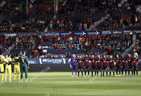 Villarreal's and Osasuna's players observe a minute of silence to commemorate late journalists Fermin Zariquiegui and Javier Martinez Zuniga before the Spanish LaLiga soccer match between Villarreal and Osasuna at El Sadar stadium in Pamplona, Navarra, Spain, 05 October 2019.