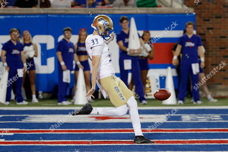Tulsa punter Thomas Bennett punts the ball from the end zone during the first half of an NCAA college football game against SMU, in Dallas, Texas. SMU beat Tulsa 43-37