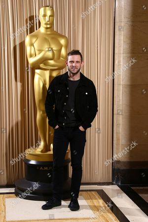 Stock Image of Jamie Bell poses for photographers upon arrival at the The Academy of Motion Pictures and Sciences new members reception in central London