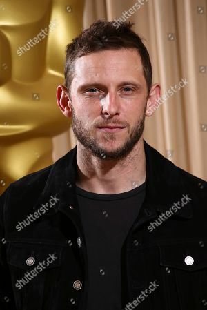 Jamie Bell poses for photographers upon arrival at the The Academy of Motion Pictures and Sciences new members reception in central London