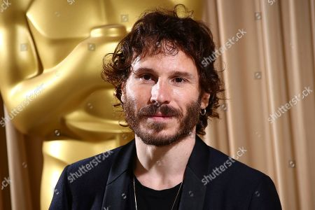 Ruben Ochandiano poses for photographers upon arrival at the The Academy of Motion Pictures and Sciences new members reception in central London