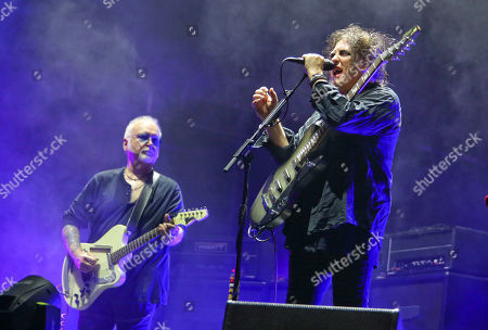 Robert Smith, Reeves Gabrels. The Cure's Robert Smith, right, and Reeves Gabrels performs during the first weekend of the Austin City Limits Music Festival in Zilker Park, in Austin, Texas