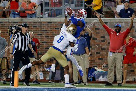 SMU wide receiver James Proche, top, catches a touchdown pass while Tulsa safety Brandon Johnson (8) defends during the third overtime of an NCAA college football game, in Dallas, Texas. SMU won 43-37