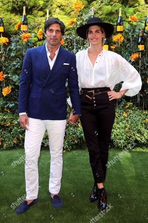 Stock Picture of Nacho Figueras, Delfina Blaquier. Nacho Figueras, left, and Delfina Blaquier attend the 10th Annual Veuve Clicquot Polo Classic at Will Rogers State Historic Park, in Los Angeles, Calif