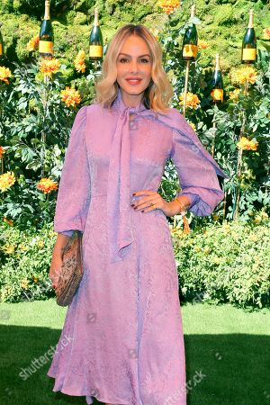 Monet Mazur attends the 10th Annual Veuve Clicquot Polo Classic at Will Rogers State Historic Park, in Los Angeles, Calif