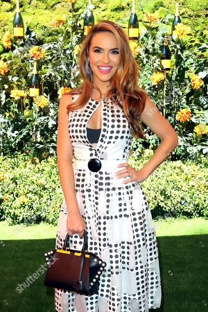 Chrishell Hartley attends the 10th Annual Veuve Clicquot Polo Classic at Will Rogers State Historic Park, in Los Angeles, Calif