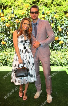 Stock Photo of Chrishell Hartley, Justin Hartley. Chrishell Hartley, left, and Justin Hartley attend the 10th Annual Veuve Clicquot Polo Classic at Will Rogers State Historic Park, in Los Angeles, Calif