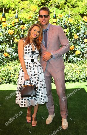 Stock Picture of Chrishell Hartley, Justin Hartley. Chrishell Hartley, left, and Justin Hartley attend the 10th Annual Veuve Clicquot Polo Classic at Will Rogers State Historic Park, in Los Angeles, Calif