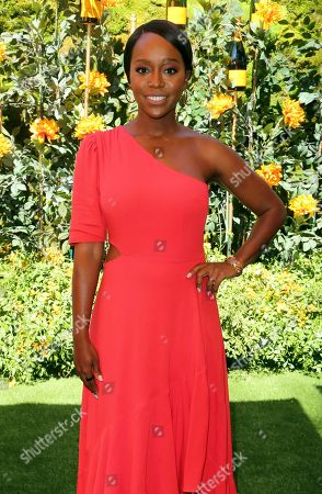 Aja Naomi King attends the 10th Annual Veuve Clicquot Polo Classic at Will Rogers State Historic Park, in Los Angeles, Calif