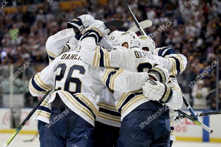 Buffalo Sabres celebrate after right wing Kyle Okposo (21) scored a goal during the second period of an NHL hockey game against the New Jersey Devils, in Buffalo, N.Y