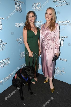 Caroline Zuendel, Wendi McLendon-Covey. Wendi McLendon-Covey, right, poses with Caroline Zuendel and Sgt. Yeager, 2019 military dog of the year, at the 2019 American Humane Hero Dog Awards at The Beverly Hilton, in Beverly Hills, Calif
