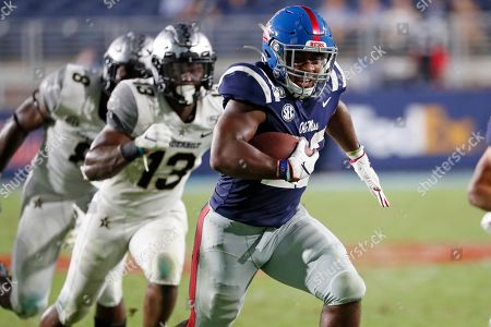 Scottie Phillips, Brendon Harris. Mississippi running back Scottie Phillips (22) runs past Vanderbilt safety Brendon Harris (13) on his way to a 24-yard touchdown during the second half of an NCAA college football game in Oxford, Miss., . Mississippi won 31-6