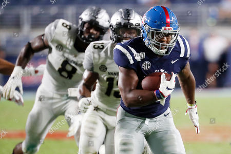 Stock Photo of Mississippi running back Scottie Phillips (22) runs past Vanderbilt safety Brendon Harris (13) on his way to a 24-yard touchdown run during the second half of their NCAA college football game in Oxford, Miss., . Mississippi won 31-6