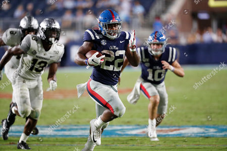 Mississippi running back Scottie Phillips (22) runs past Vanderbilt safety Brendon Harris (13) on his way to a 24-yard touchdown run during the second half of their NCAA college football game in Oxford, Miss., . Mississippi won 31-6