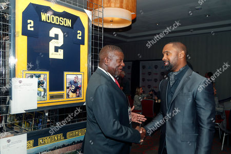Charles Woodson, LaVal Perry. Charles Woodson, right, meets with LaVal Perry, director of the Michigan Sports Hall of Fame, before a ceremony, in Detroit where Woodson was inducted into the hall. He led the 1997 Michigan game, which was ranked No. 1 by many polls, and won the Heisman Trophy. Woodson was elected in the amateur category along with Morris Peterson, who helped Michigan State win the 2000 NCAA basketball title