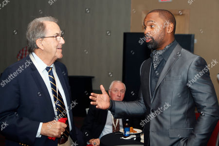 Charles Woodson, Lloyd Carr. Charles Woodson, right, meets with former Michigan football coach Lloyd Carr before a ceremony, in Detroit where Woodson was inducted into the Michigan Sports Hall of Fame. He led the 1997 Michigan team, which was ranked No. 1 in many polls, and won the Heisman Trophy. Woodson was elected in the amateur category along with Morris Peterson, who helped Michigan State win the 2000 NCAA basketball title