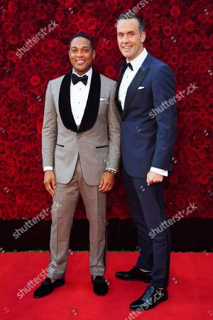 Don Lemon and Tim Malone pose for a photo on the red carpet at the grand opening of Tyler Perry Studios at Tyler Perry Studios, in Atlanta