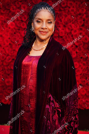 Phylicia Rashad poses for a photo on the red carpet at the grand opening of Tyler Perry Studios, in Atlanta