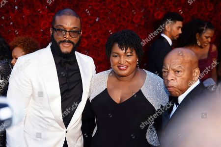 Tyler Perry, Stacey Abrams, and U.S. Rep. John Lewis, D-Ga., pose for a photo on the red carpet at the grand opening of Tyler Perry Studios, in Atlanta