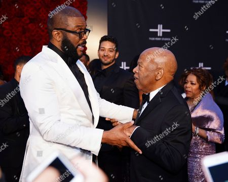 Tyler Perry, left, greets U.S. Rep. John Lewis, D-Ga., on the red carpet at the grand opening of Tyler Perry Studios, in Atlanta