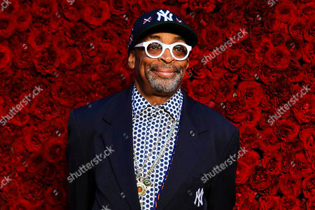 Stock Photo of Spike Lee poses for a photo on the red carpet at the grand opening of Tyler Perry Studios, in Atlanta