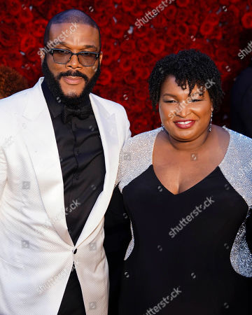 Tyler Perry, Stacey Abrams. Tyler Perry, left, and former Georgia House Minority Leader Stacey Abrams pose for a photo on the red carpet at the grand opening of Tyler Perry Studios, in Atlanta