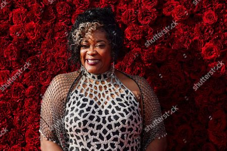 Loretta Devine poses for a photo on the red carpet at the grand opening of Tyler Perry Studios, in Atlanta