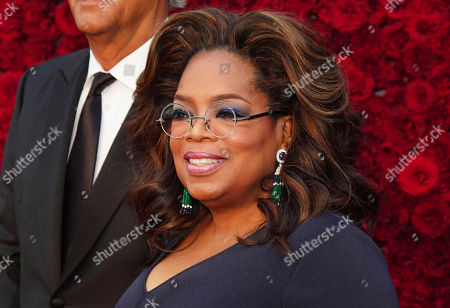 Oprah Winfrey poses for a photo on the red carpet at the grand opening of Tyler Perry Studios, in Atlanta