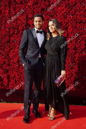 Michael Ealy, Khatira Rafiqzada. Michael Ealy and Khatira Rafiqzada pose for a photo on the red carpet at the grand opening of Tyler Perry Studios, in Atlanta