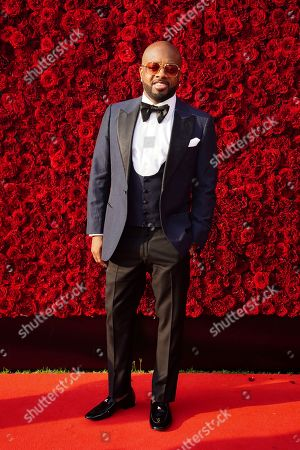 Jermaine Dupri poses for a photo on the red carpet at the grand opening of Tyler Perry Studios, in Atlanta