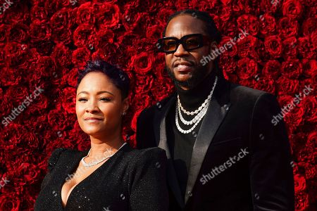 Stock Image of Kesha Ward, 2 Chainz, Tauheed Epps. Kesha Ward, left, and 2 Chainz pose for a photo on the red carpet at the grand opening of Tyler Perry Studios, in Atlanta