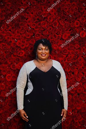 Former Georgia House Minority Leader Stacey Abrams poses for a photo on the red carpet at the grand opening of Tyler Perry Studios, in Atlanta
