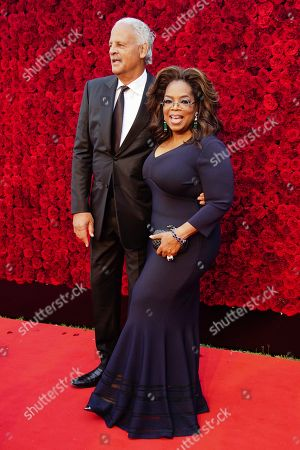 Stock Picture of Stedman Graham, Oprah Winfrey. Oprah Winfrey and Stedman Graham pose for a photo on the red carpet at the grand opening of Tyler Perry Studios, in Atlanta
