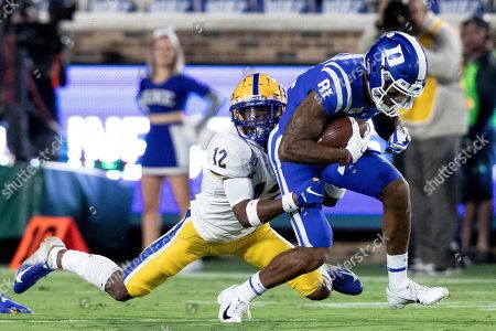 Duke's Aaron Young (81) is tackled by Pittsburgh's Paris Ford (12) during the first half of an NCAA college football game in Durham, N.C