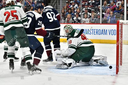 Stock Image of Minnesota Wild goaltender Devan Dubnyk (40) looks back at the puck as it bounces back out on a score by Colorado Avalanche right wing Mikko Rantanen during the first period in an NHL hockey game in Denver