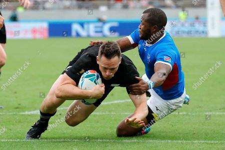 Stock Image of New Zealand's Ben Smith, left, dives across the line in the tackle of Namibia's Lesley Klim to score a try during the Rugby World Cup Pool B game at Tokyo Stadium between New Zealand and Namibia in Tokyo, Japan