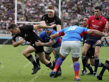 Stock Photo of Ben Smith (L) of New Zealand breaks the defense of Johan Coetzee (C) of Nambia during the Rugby World Cup match between New Zealand and Namibia at Tokyo Stadium, Tokyo, Japan, 06 October 2019.