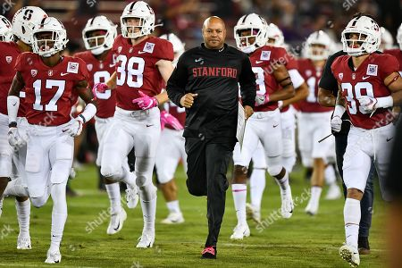 Stanford Cardinal head coach David Shaw leads his team on the field before the NCAA football game between the Washington Huskies and the Stanford Cardinal at Stanford Stadium in Stanford, California